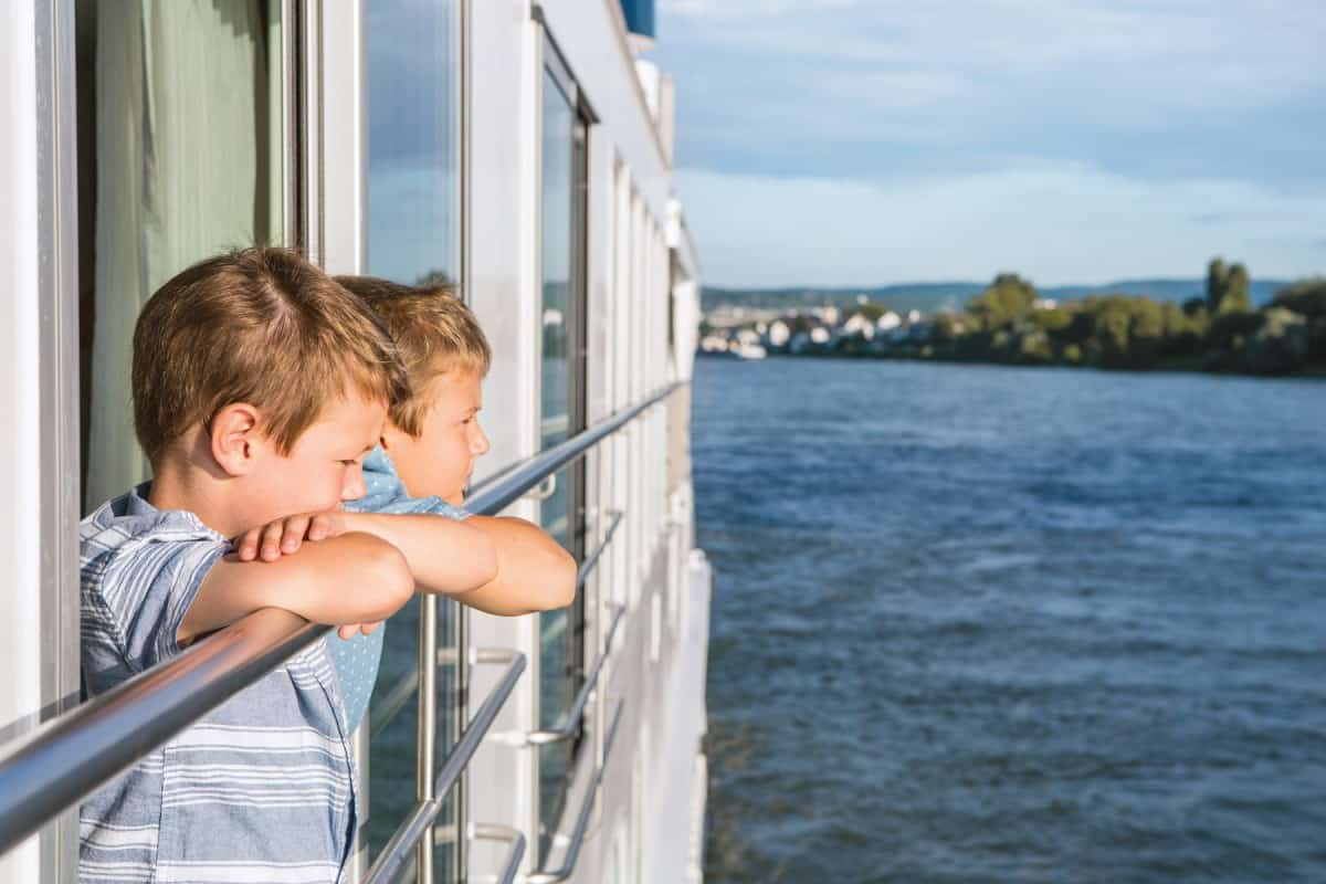 Boys looking out of cabin window on cruise - The Birmingham Cruise Show