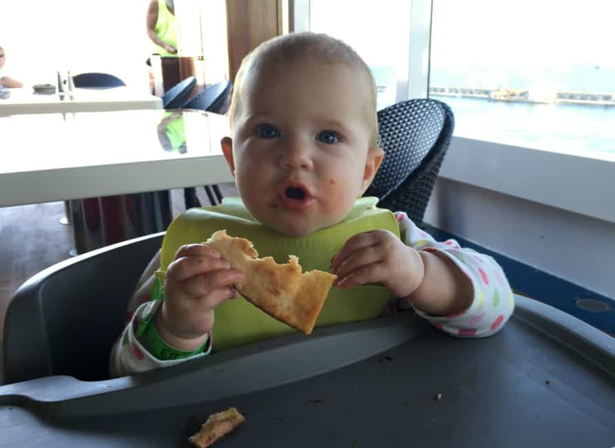 Baby eating on Carnival Vista - cruising with a baby, what you need to know