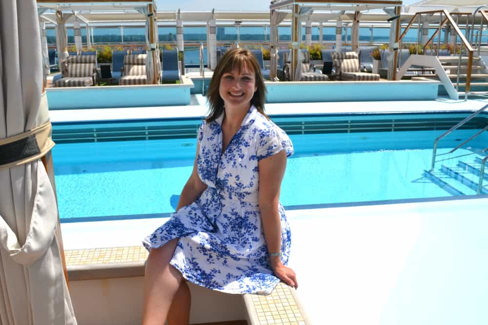 Claire from Tin Box Traveller by Retreat Pool on Royal Princess - Cruising with Kids editor