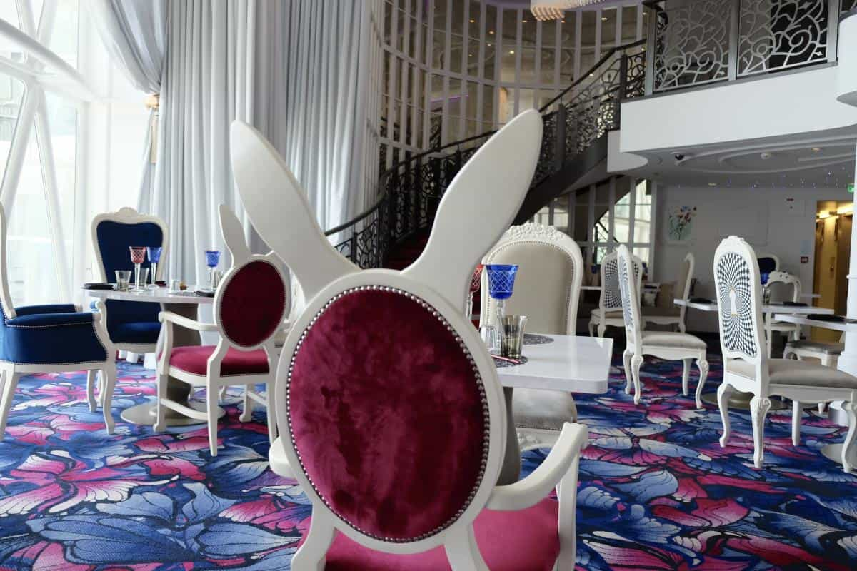 Rabbit ears chairs in Wonderland restaurant Symphony of the Seas