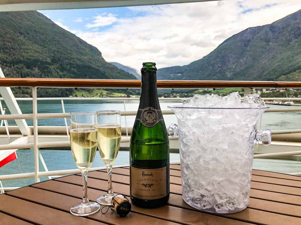 Have bottle of champagne on the balcony of your cruise ship with views over the Norwegian fjords